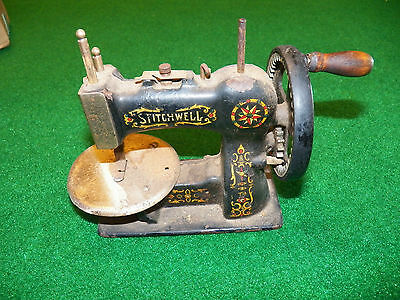 Antique Cast Iron Stitchwell Toy Sewing Machine