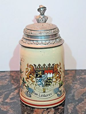Antique 1/2L German Stoneware Beer Stein with Crest and Lions and Figural Thumb