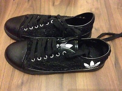 black trainers size 6