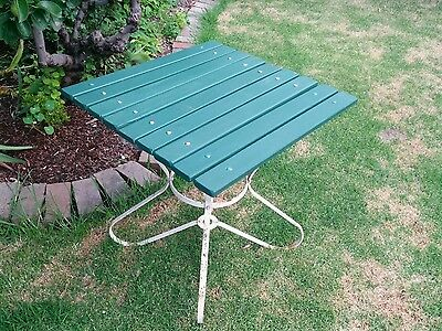vintage wrought iron and timber slats garden table