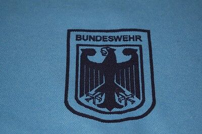3 BUNDESWEHR-Sporthemden. THREE Original issued BUNDESWEHR T-Shirts, pale blue.