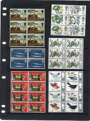 Collection of blocks of mint nbh pre-decimal commemorative QEII stamps.