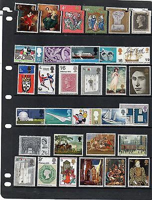 Collection of mint nbh pre-decimal commemorative QEII stamps.