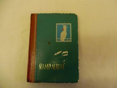 Small Stamp Album With WorldWide Stamps .