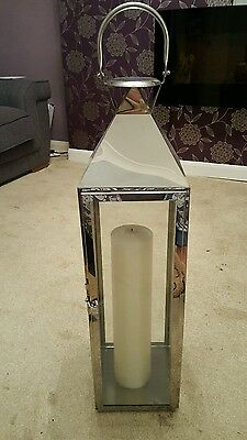 Large stainless steel lantern with candle