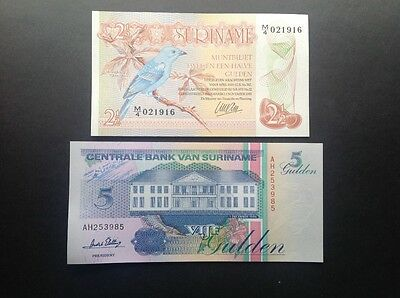 Two uncirculated banknotes from Suriname.