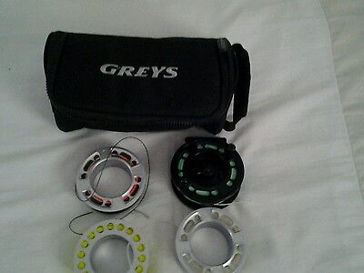 grey GRXI fly reel with spare spools