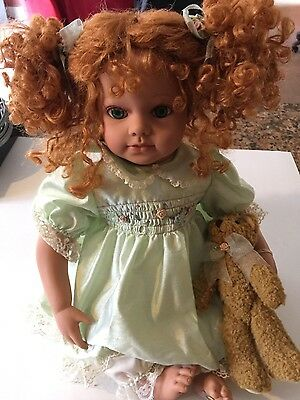 seymore mann porcelian doll hugs and hold collection