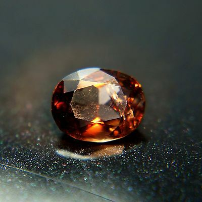 1.69 Ct Top Luster Oval Greenish-Brown to Red Color Change Unheated Axinite