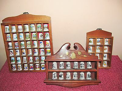 Superb collection of 66 bone china collectable thimbles in wooden display stands