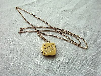 An SOS GOLD PLATED MEDICAL ALERT PENDANT LOCKET and CHAIN