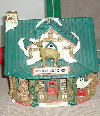 Santa's Best Christmas In The Rockies  Bear Creek Sporting Goods  lighted house