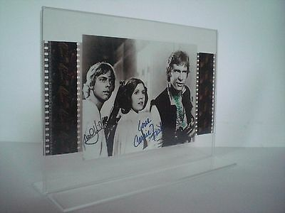 STAR WARS 4 -Mark Hamill-Carrie Fisher-Harrison Ford- Film-Cell-Collage signiert