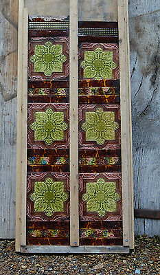 A SET OF GREEN AND BROWN DECORATIVE VICTORIAN FIREPLACE TILES ref 609