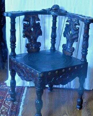 Victorian Heavily Carved Figural Dark Mahogany Face Chair Embossed Leather