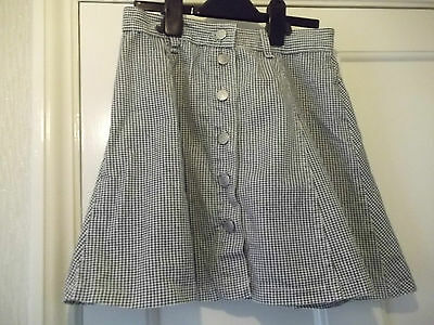 Clock House Girls Skirt. Black and Grey Check. Size 12.