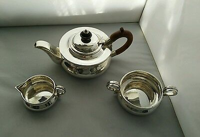 an Edwardian sterling silver three piece bachelor's tea set