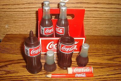 6 Collectible Coca-Cola Mini Bottles with Carrier Pen & Pencil sets in Bottles