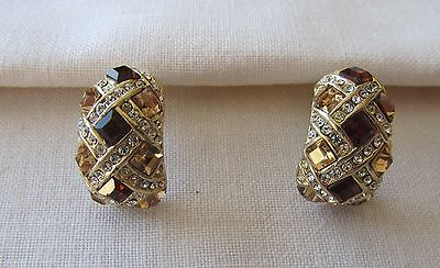 Vintage gold tone pin earrings with brown and yellow rhinestones