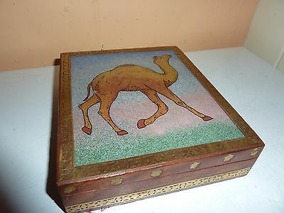 16.1 By 13.6Cm Wood &brass Pattern Box With Sand Picture Of A One Hump Camel Lid