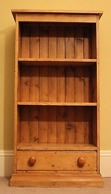 Antique pine Victorian open bookcase with single low drawer