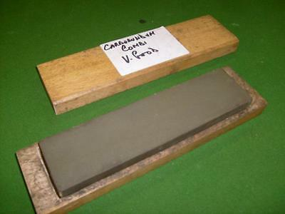 Combination sharpening stone by Carborundum, Manchester in good wooden box.