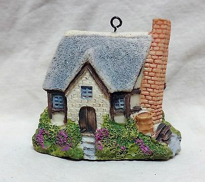 "old Christmas Ornament - hard resin English Cottage  about 2"" tall"
