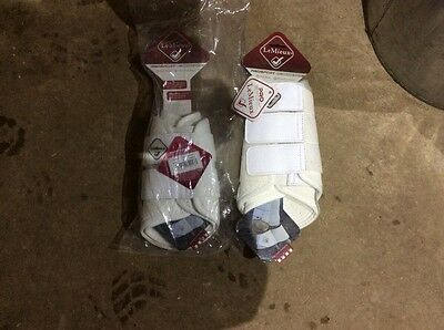 Lemieux brushing boots in white, pair M and Pair L brand new