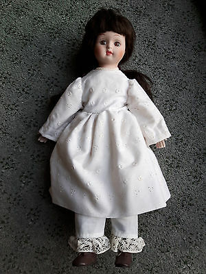 Doll in vintage clothing  (Stands approx 48cm tall)