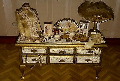 Dolls house decorated sideboard