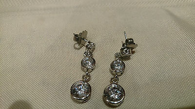 Silver dangle earings with 3 cut glass stones in each