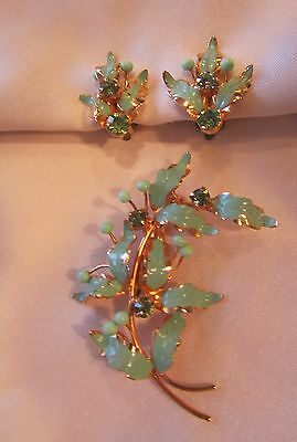 Vintage gold tone set of painted brooch and earrings with green rhinestones