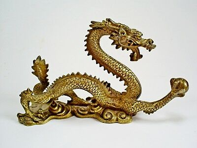 Vintage/antique Chinese Solid Cast Brass Dragon Clutching The Celestial Pearl