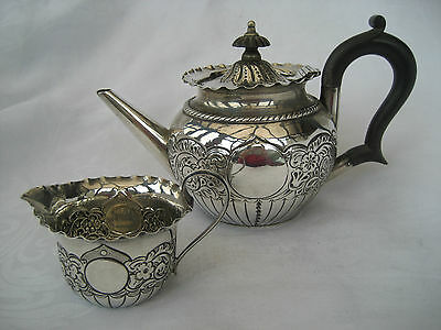 VICTORIAN SILVER BACHELOR TEAPOT AND JUG - J Deakin & Sons, 1892.