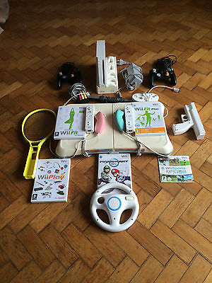PACK WII ( Console + Accessoires + 4Jeux + Pack Mario Kart )