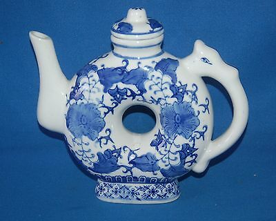 Unmarked blue and white floral donut teapot