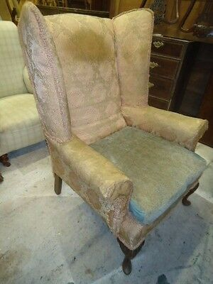 Antique Victorian wing armchair with cushion and carved legs for upholstery