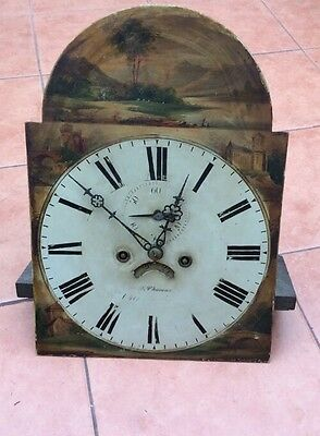 old vintage grandfather clock movement with dial and hands