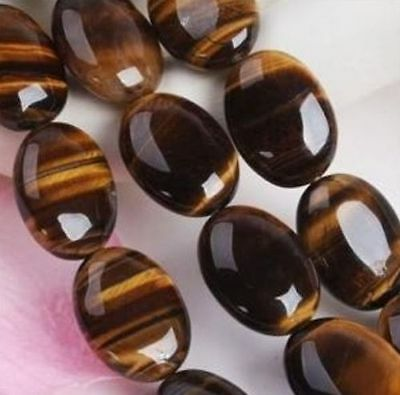 5 PIECES OF 7x5mm OVAL CABOCHON-CUT NATURAL AFRICAN GOLDEN TIGERS-EYE £1 NR!