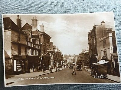 Chippenham High Street with shop Fronts vintage cars NEWMAN Boots