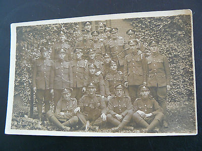 Real Photo postcard showing Royal Artillery Soldiers & Dog possibly a Labrador