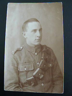 Real Photo RP Postcard showing British Army Soldier - shoulder badge