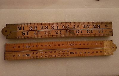 2 VINTAGE SYBREN WOODEN AND BRASS FOLDING RULERS. (No73/74)