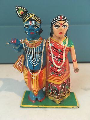 Indian hand carved and painted figures of Krishna and his consort, Radha