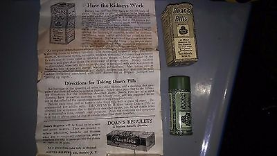 Vintage tin of Doans Pills, original box, paper directions, and contents