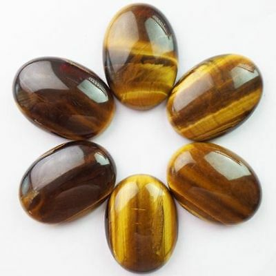 A PAIR OF 12x10mm OVAL CABOCHON-CUT NATURAL AFRICAN GOLDEN TIGERS EYE GEMSTONES