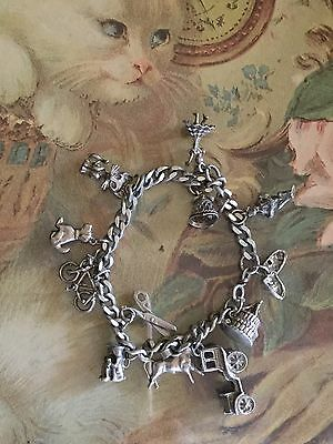 VINTAGE STERLING SILVER CHARM BRACELET WITH 12 CHARMS Very Pretty!