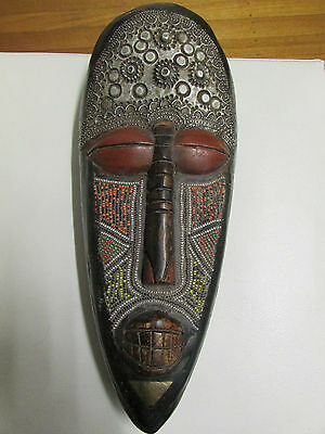 African Ivory Coast wall Mask glass bead inlay embossed metal adorned