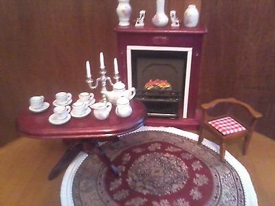 Dolls House12th scale dining table, rug, large fireplace and lots of accessories
