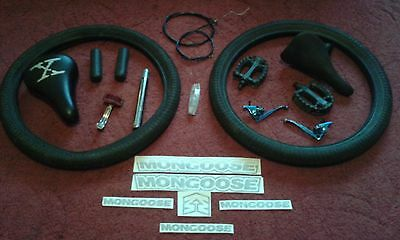 BMX parts job lot.seat post.seats pedals,brake levers,cables,grips,tyres.decals